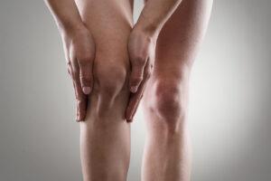Woman touching her injured knee