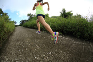 young fitness woman trail